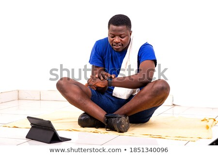 Young man muscular adjusting his watch Stock photo © FreeProd