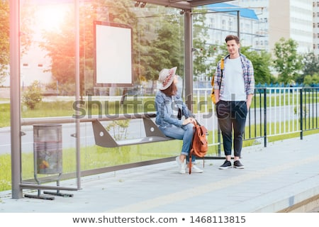 Woman waiting at tram stop Stock photo © IS2