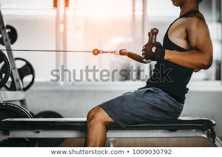 ストックフォト: フィットネス · 低い · ローイング · ハンサムな男 · マシン