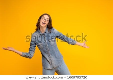young brunette girl with glasses the girl spread her hands to the sides stock photo © traimak