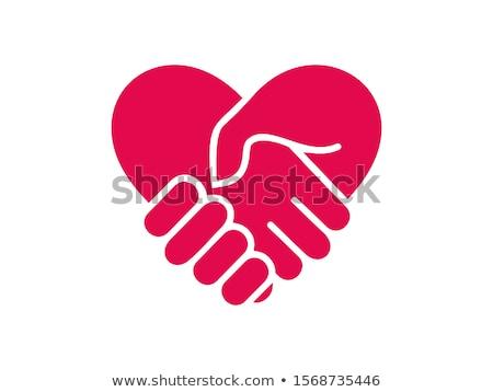 Helping Hands Glyph Vector Icon. Stock photo © smoki