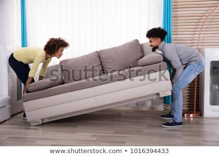 Сток-фото: Side View Of An African Couple Carrying Sofa