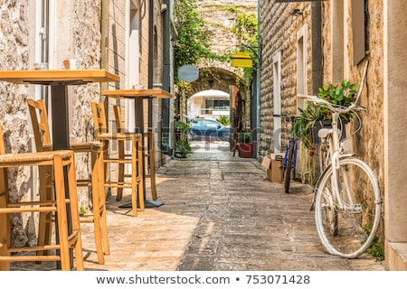 Old stone houses with windows with shutters in Budva in Montenegro Stock photo © bezikus