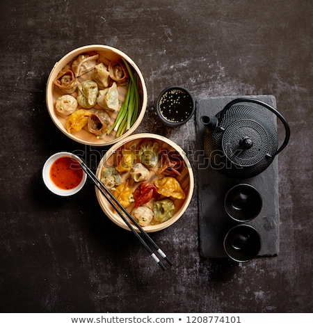 Composition of chinese food. Mixed kinds of dumplings from woode Stock photo © dash