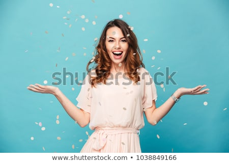 portrait of an excited young girl in dress stock photo © deandrobot