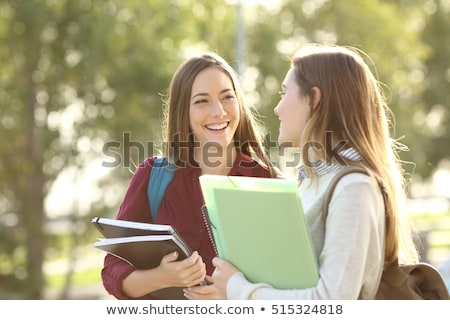 Group of happy student walking at the campus outdoors Stock photo © deandrobot
