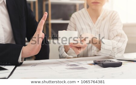 Man Refusing Cup Of Coffee Offered By Person Stock photo © AndreyPopov