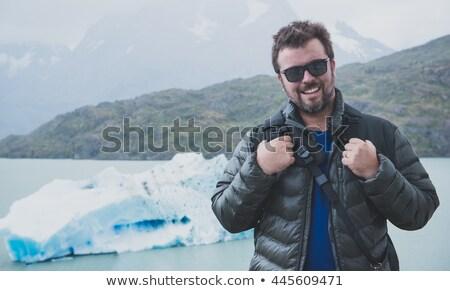 Férfi pózol kamera jéghegy természet pár Stock fotó © Lopolo