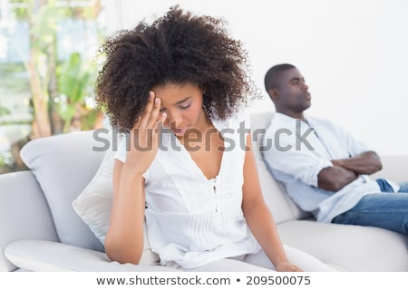 Ontdaan afrikaanse paar vergadering sofa jonge Stockfoto © AndreyPopov