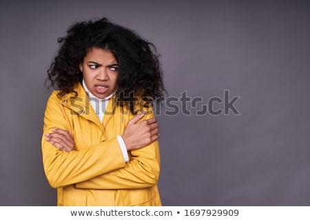 Fagyott fiatal lány visel esőkabát áll izolált Stock fotó © deandrobot