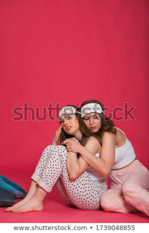 Two upset girls wearing pajamas standing Stock photo © deandrobot