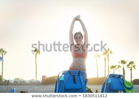 Foto caucásico mujer largo pelo oscuro gafas de sol Foto stock © deandrobot