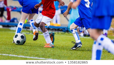 young boys in blue and red soccer jersey shirts and soccer cleat stock photo © matimix