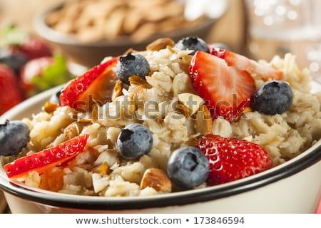 Healthy Tasty Homemade Oatmeal with Berries for Breakfast Stock photo © Melnyk