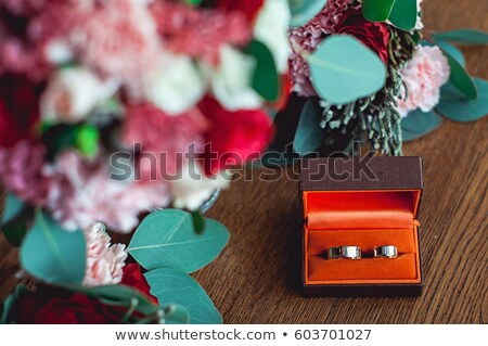 wedding rings in the box and a bouquet of the bride on the table Stock photo © ruslanshramko