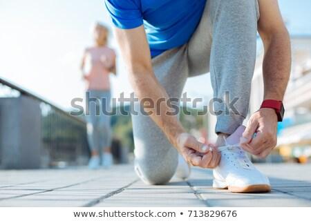 Man tying shoelace Stock photo © pressmaster