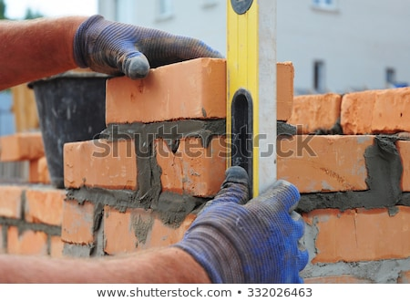 Worker Building Wall with Red brick and Cement Stock photo © robuart