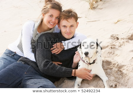 Portrait Of Romantic Teenage Couple On Beach With Dog Stock photo © monkey_business