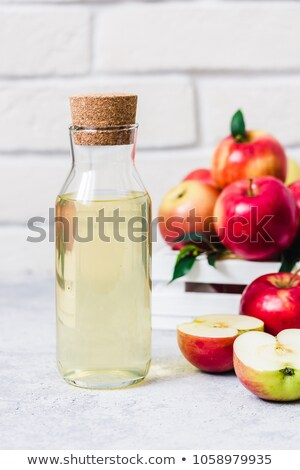 Bottle of homemade organic apple cider with fresh apples in box on wooden background. Space for text Stock photo © DenisMArt