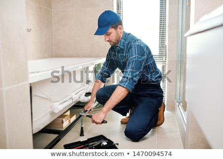 молодые водопроводчика техник подробность ванна установка Сток-фото © pressmaster