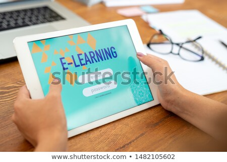Touchpad held by young female student of educational website Stock photo © pressmaster