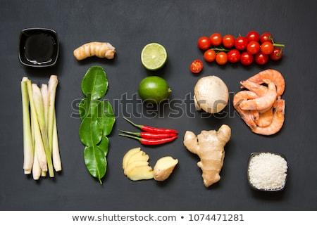 Ingredients for popular Thai soup Tom-yum kung. Lime, galangal, red chili, cherry tomato, lemongrass Stock photo © galitskaya