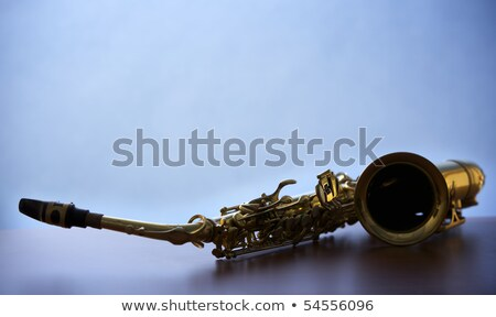 Macro of saxophone on wooden board, backlit Stock photo © lichtmeister