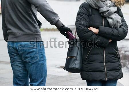 Rapinatore rubare frizione donna cardigan tasca Foto d'archivio © AndreyPopov