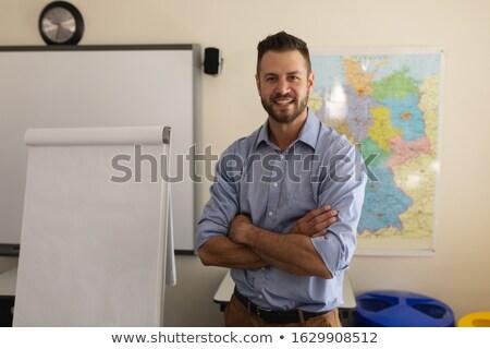 Mutlu okul öğretmen silah katlanmış bakıyor Stok fotoğraf © wavebreak_media
