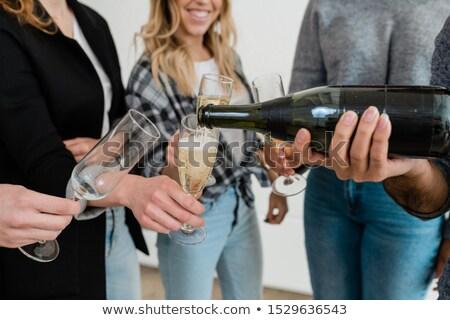 Genç şişe şampanya bir flüt Stok fotoğraf © pressmaster