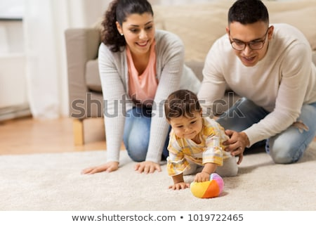 father and little baby daughter with ball at home Stock photo © dolgachov