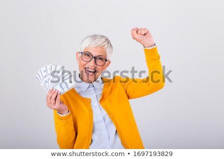 senior woman with hundred dollar money banknotes Stock photo © dolgachov