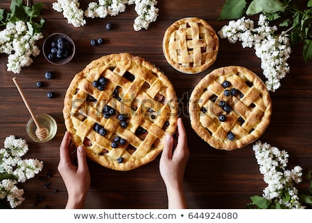 Homemade pastry apple pie with bakery products on dark wooden kitchen table Stock photo © dash