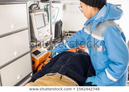 молодые фельдшер равномерный кнопки медицинской Сток-фото © pressmaster