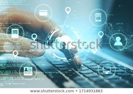 biznesmen · garnitur · wpisując · multimedialnych · powyżej · tabeli - zdjęcia stock © ra2studio