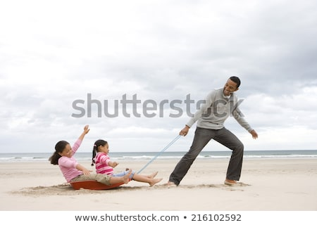 Father And Daughter Playing On Sled Stock photo © AndreyPopov