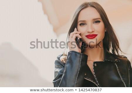 Atractivo femenino teléfono móvil mejor amigo de moda ropa Foto stock © vkstudio