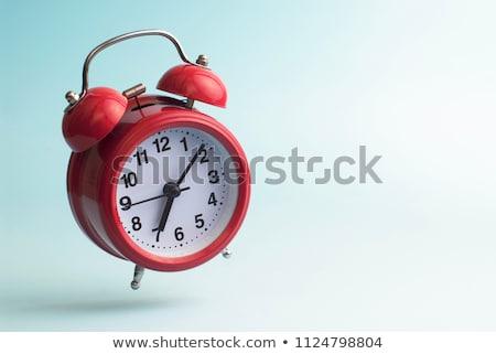 Red retro styled classic alarm clock isolated Stock photo © dmitry_rukhlenko