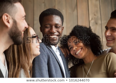Portrait of excited multinational women laughing and hugging Stock photo © deandrobot