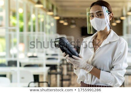 Waitress with face mask hold credit card reader. Stock photo © vichie81