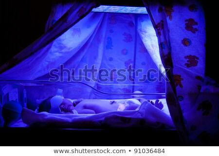 újszülött · baba · ultraibolya · fény · lámpa · gyerekek - stock fotó © phakimata