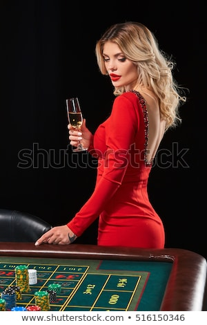 pretty woman gambling on red table stock photo © imarin