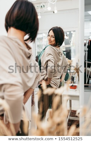 Brunette woman trying on clothes Stock photo © photography33