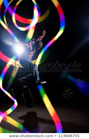 Stock photo: Skateboarder with Abstract Light Trails