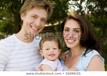 Stok fotoğraf: Parents Laughing With Their Daughter