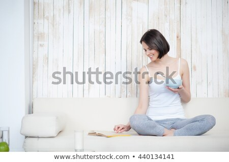 Woman having breakfast in her living room Stock photo © photography33