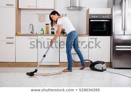 Stock photo: woman holding vacuum cleaner