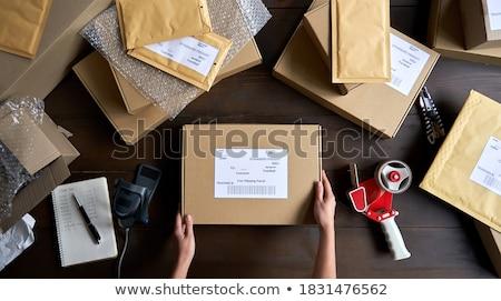 entrega · persona · paquetes · azul - foto stock © photography33