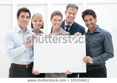 Stockfoto: Business Team Holding Blank Poster