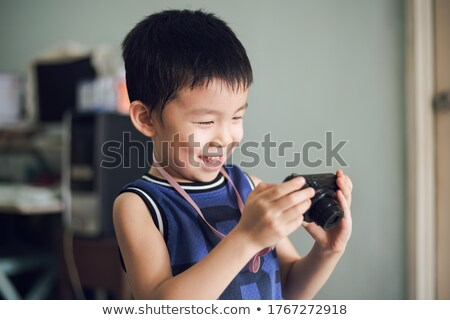 Stock photo: young child with digital camera